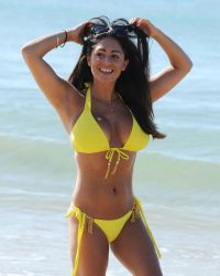 Casey Batchelor in a Yellow Bikini on the Beach in Portugal | Picture 1524746