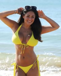 Casey Batchelor in a Yellow Bikini on the Beach in Portugal | Picture 1524739
