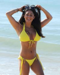 Casey Batchelor in a Yellow Bikini on the Beach in Portugal | Picture 1524742