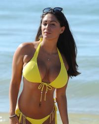 Casey Batchelor in a Yellow Bikini on the Beach in Portugal | Picture 1524743