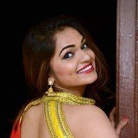 Aswini Hot in Red Saree Photos